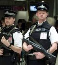 Armed police officers at London's Heathrow Airport Terminal Three following the news that Saudi Airlines flight SV115 had been hijacked Saturday Oct. 14, 2000. A hijacker seized the Boeing 777, carrying more than 100 people, bound for London from Jiddah in Saudi Arabia and ordered it to land in Syria and then Iraq.  Nothing is known about the motives or identity of the hijacker. (AP Photo/Alastair Grant)
