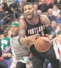 Boston Celtics' Isaiah Thomas reaches in to knock the ball away from Portland Trail Blazers' Damian Lillard (0) during the overtime of Portland's 127-123 win in an NBA basketball game in Boston Saturday, Jan. 21, 2017. (AP Photo/Winslow Townson) Trail Blazers Celtics Basketball