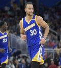 Golden State Warriors guard Stephen Curry (30) looks to a fan in the stands after making a three-point basket during the second half of an NBA basketball game against the Orlando Magic in Orlando, Fla., Sunday, Jan. 22, 2017. (AP Photo/Phelan M. Ebenhack) Warriors Magic Basketball
