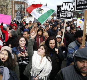 Protesters participate in a march aimed squarely at President Donald Trump's efforts to crack down on immigration Thursday, Feb. 16, 2017, in Chicago. Immigrants around the country have been staying home from work and school today, hoping to demonstrate their importance to America's economy and its way of life. (AP Photo/Charles Rex Arbogast) Day Without Immigrants Illinois